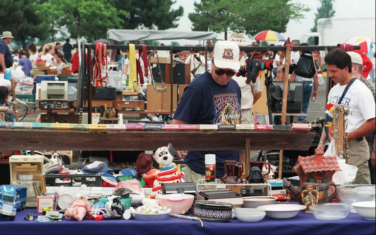 980704SI  2/6  East Rutherford, N.J.-Vendors empty their garages to bring merchandise to the Meadowlands Flea Market. 7/4/98  Photo by Samir Id-Deen